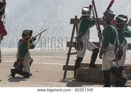 French soldiers at the barricades by firing at the enemy during Representation of the Battle of Bail