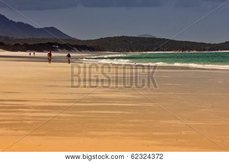 Couples walking on Whitehaven Beach