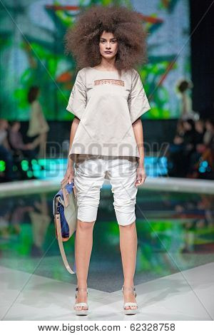 ZAGREB, CROATIA - MARCH 28, 2014: Fashion model wearing clothes designed by Marina Design and Marija Ivanovic bag on the 'Fashion.hr' fashion show