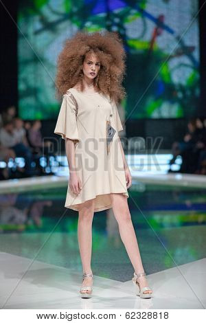 ZAGREB, CROATIA - MARCH 28, 2014: Fashion model wearing clothes designed by Marina Design and Marija Ivanovic jewelry on the 'Fashion.hr' fashion show