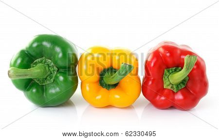 Green Yellow Red Pepper On White Background