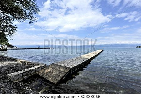 A long and a thin dock in the shore of Lake Ohrid.