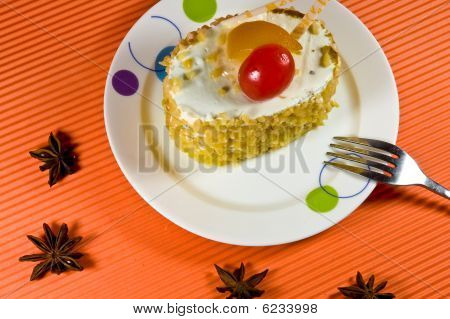 Tasty Yellow Nut  Cake With White Cream And Red Berry.