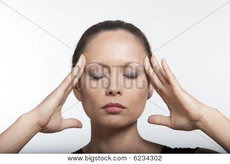 Asian Woman Massaging Her Head