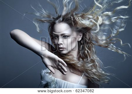 Young, beautiful blonde woman with blowing hair