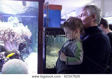 Grandfather With Grandson At Oceanarium