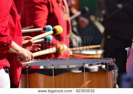 percussion instrument with drumsticks