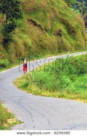 woman on the way around fewa lake,pokhara,nepal