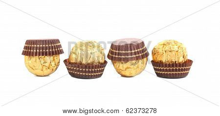 Four in row chocolate bonbons.