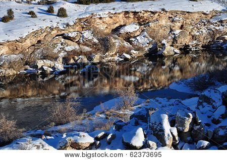 Mirrored River in the Mountains