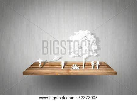Paper cut of children play on wood shelf