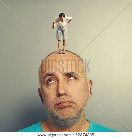 fatigued man listening angry woman on his head