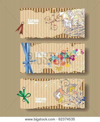 Corrugated cardboard with drawn flowers. Card