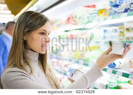 Young woman shopping at the supermarket