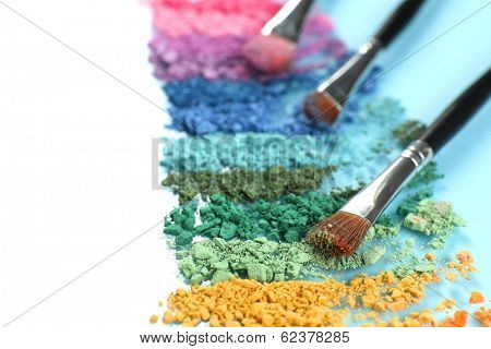 Rainbow crushed eyeshadow and professional make-up brush close up