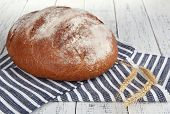 Rye bread on napkin on wooden background