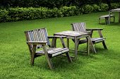 foto of lawn chair  - Wooden chair in the garden with a lawn in the background - JPG