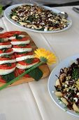 Fresh and tasty salads on party table