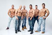 stock photo of striptease  - Group of six muscular young sexy wet naked handsome man posing - JPG
