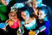 stock photo of night-club  - Above angle of happy friends cheering up at party - JPG