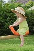 young girl on seesaw