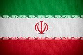 stock photo of iranian  - flag of Iran or Iranian banner on paper background - JPG