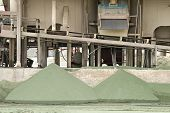 picture of slag  - Piles of old nickle slag at a processing plant making sand blasting media - JPG
