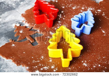 Baking Ginger Bread Cookies As Christmas Trees With Colorful Forms