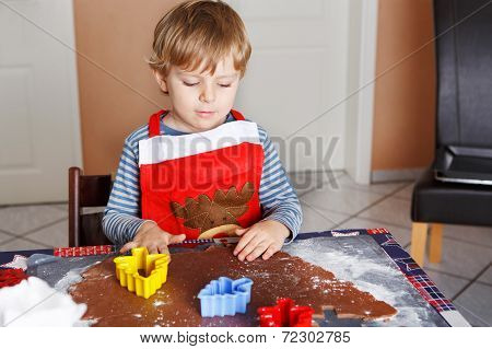 Cute Little Child Baking Ginger Bread Cookies For Christmas