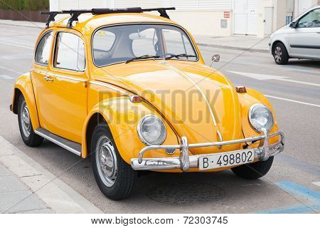 Calafel, Spain - August 20, 2014: Yellow Volkswagen Kafer Stands Parked On The Roadside