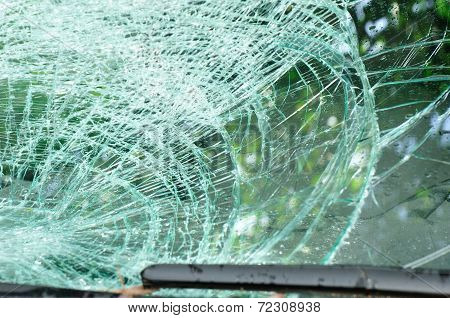 broken windshield of car by typhoon