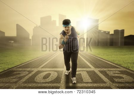 Overweight Person Run On Track
