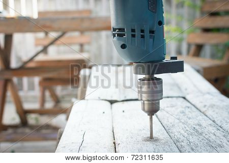 Electric drill on the table