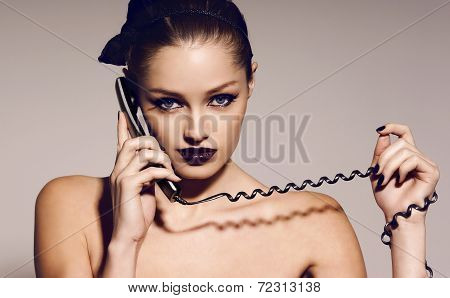 Portrait Of Beautiful Girl With Dark Hair Speaking By Telephone