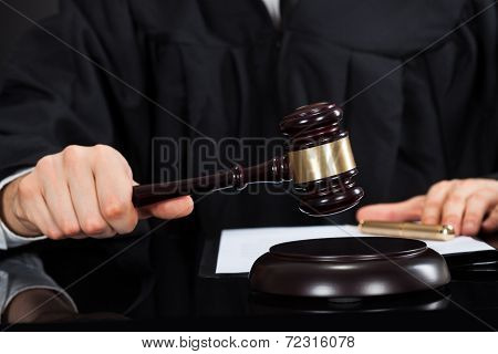 Judge With Mallet At Desk