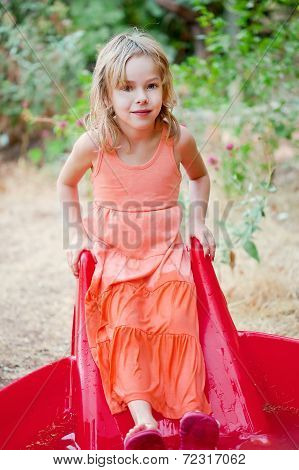 Little Girl In A Yard Pool