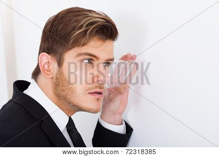 Businessman Eavesdropping In Office