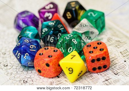 role playing dices lying on sketch map
