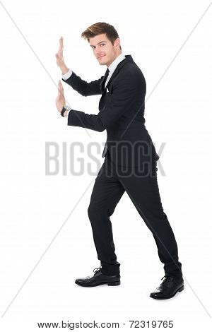 Businessman Pushing Invisible Wall