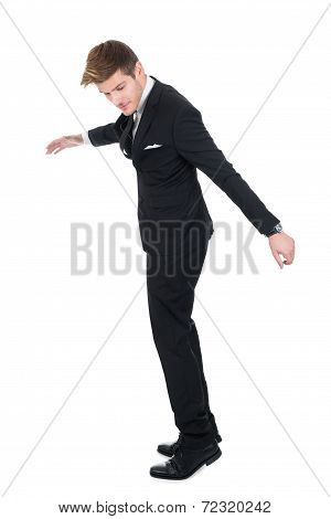 Businessman About To Fall