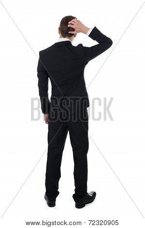 Confused Businessman Scratching His Head