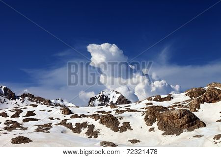 Snowy Rocks And Sky With Clouds At Nice Day