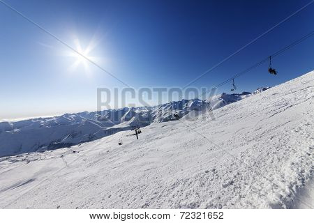 Off-piste Slope And Blue Sky With Sun