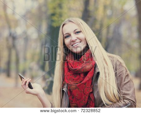 Portrait Of A Smiling Beautiful Woman Texting Sms