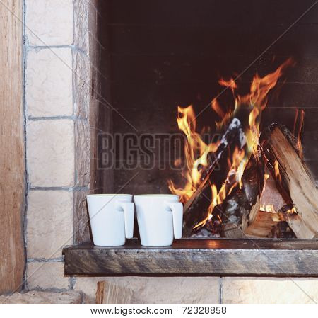 Two Mugs Near The Fireplace