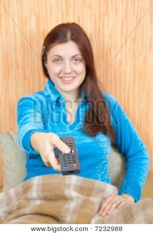 Woman Smiling With Tv Remote Control
