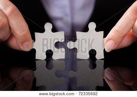 Businessperson Holding Puzzle