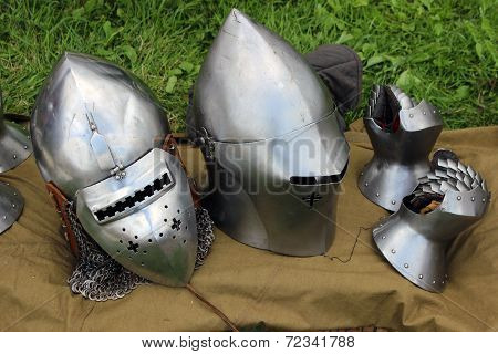 Two Helmets And Mail Gloves
