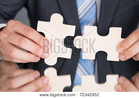 Hands Connecting Puzzle Pices