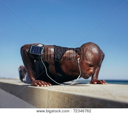 Sporty Man Doing Push-ups Outdoors